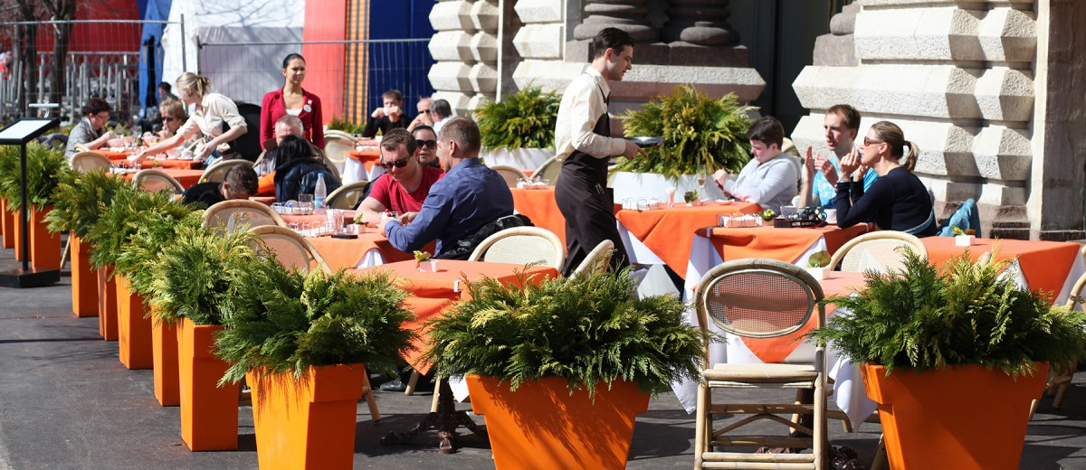 People enjoy lunch meal at restaurant in Moscow